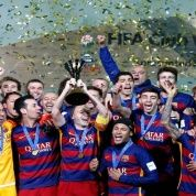 F.C. Barcelona celebrate winning the FIFA Club World Cup Final with the trophy.