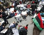 Protesters lie down on Chicago's Michigan Avenue in front of the Disney Store during a protest march against police violence in Chicago, Dec. 24, 2015
