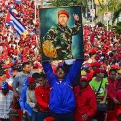 Venezuelan president Nicolas Maduro holds a picture of the late Venezuelan president Hugo Chavez during a rally in the port city of Catia La Mar, in northern Vargas state.