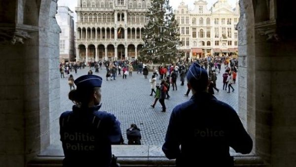 Belgian police officers stand guard on Brussels