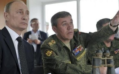 Russian President Vladimir Putin (L) and Chief of Staff Valery Gerasimov watch military exercises in Russia