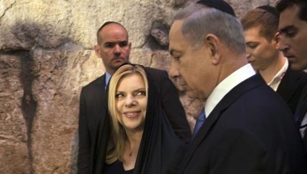 Netanyahu leaves with his wife Sara after he delivered a statement to the media in Jerusalem