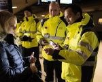 Security staff check a traveler's identification at Kastrups train station outside Copenhagen, Denmark.