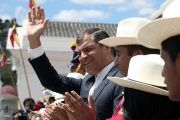 Rafael Correa waves from the presidential palace in Quito, Dec. 28, 2015.