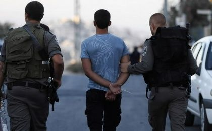 Israeli security forces arrest a Palestinian youth in East Jerusalem.