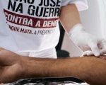 A nurse takes a blood sample to test for dengue fever, in a medical tent in Sao Jose dos Campos, Brazil, May 7, 2015.