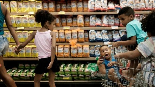Children at a supermarket in Rio de Janeiro on Dec. 21, 2015 as Brazilians shop for Christmas groceries