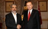 Turkish President Tayyip Erdogan (R) meets with Hamas leader Khaled Meshaal in Istanbul, Turkey.