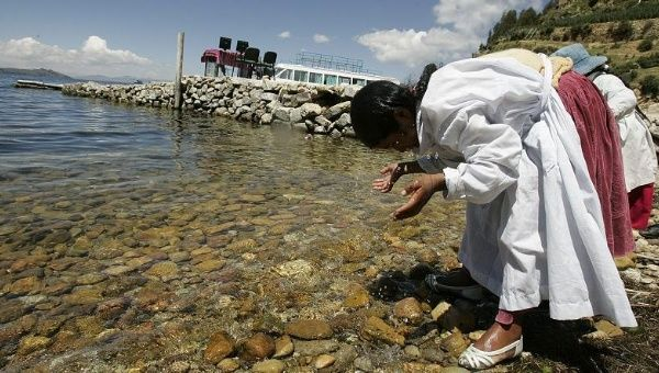 Two young Bolivians wash their faces at the edge of Lake Titicaca, Bolivia, March 4, 2009.