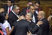 National Assembly President Henry Ramos Allup embraces fellow MUD legislators in parliament.