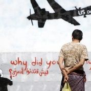 Men look at graffiti showing a U.S. drone on a wall in Sanaa in this Nov. 9, 2013, file photo.