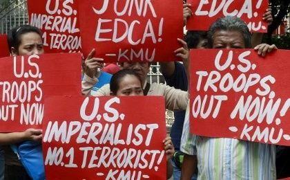 Activists hold placards denouncing the Enhanced Defense Cooperation Agreement (EDCA) during a protest outside the Supreme Court in Manila January 12, 2016.