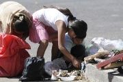 Children look for scraps outside a market in Guatemala City.