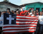 Liberians during an official celebration of the country being declared Ebola-free, although it was a false down, in Monrovia, Liberia, May 11, 2015.