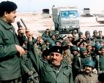 Iraqi leader Saddam Hussein addresses his troops in 1990.