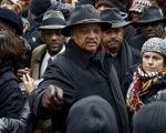 Rev. Jesse Jackson joins demonstrators in a protest to disrupt Black Friday shopping in Chicago, Illinois, Nov. 27, 2015.