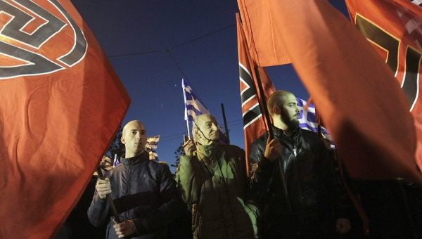Golden Dawn party supporters demonstrate against the presence of migrants without papers in Greece, during the World Day against Racism, Athens, March 21, 2015.