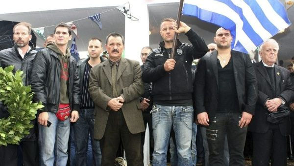 Golden Dawn members, including lawmaker Christos Pappas (4thR) attend a ceremony for killed Greek WW2 soldiers in Albania, Oct. 28, 2012.