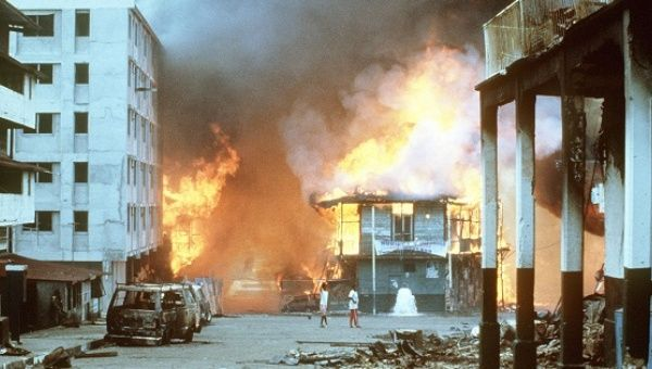 Flames engulf a building after U.S. forces invaded Panama during Operation Just Cause Dec. 20, 1989.