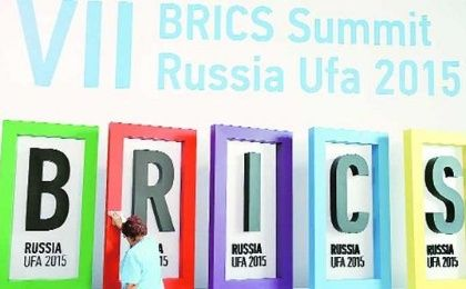 An employee cleans a board during the preparations for the BRICS summit in Ufa, Russia.
