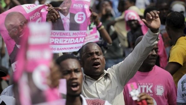 Opposition supporters in Haiti march Jan. 28, 2016.