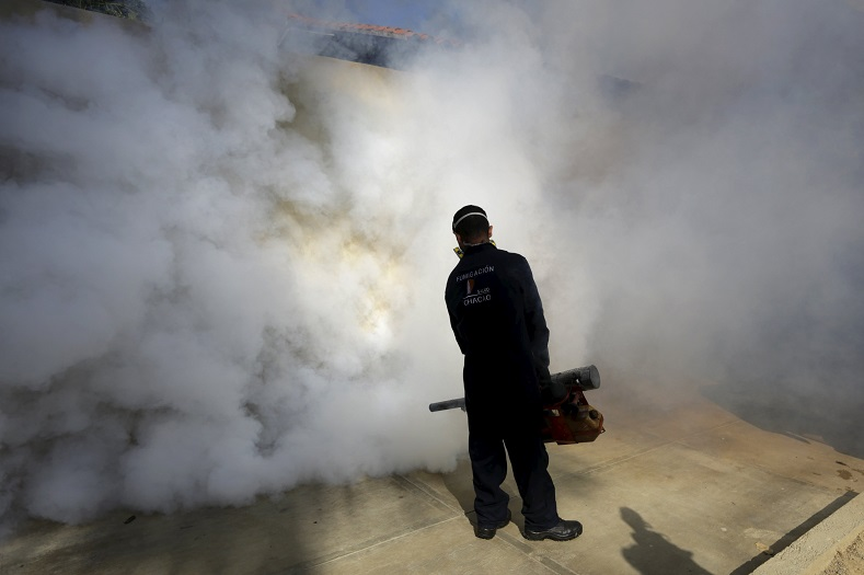 A municipal worker carries out fumigation to help control the spread of the mosquito-borne Zika virus in Caracas, Venezuela Jan. 28, 2016.