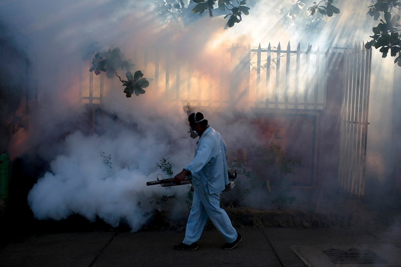 A health ministry worker fumigates a house to kill mosquitoes during a campaign against dengue and chikungunya and to prevent the entry of Zika virus in Managua, Nicaragua Jan. 26, 2016.