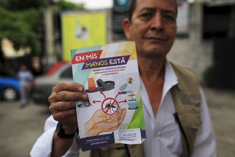 A health worker shows a flier used to explain people how to prevent Dengue, Chikungunya and Zika viruses in San Salvador, El Salvador Jan. 28, 2016.