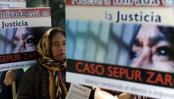 Women carry signs that read 'We look to justice, Sepur Zarco case' in a demonstration against violence against women in Guatemala City in 2012.