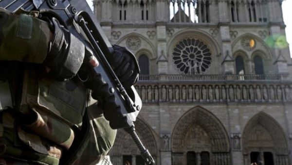 An armed French soldier patrols in front of Notre Dame Cathedral in Paris, France, in this picture taken on December 24, 2015, as a security alert continued following the November shooting attacks in the French capital.