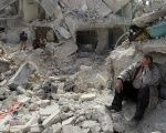 A man at a site recently hit by what activists said was a Scud missile in Aleppo's Ard al-Hamra neighborhood in Syria.