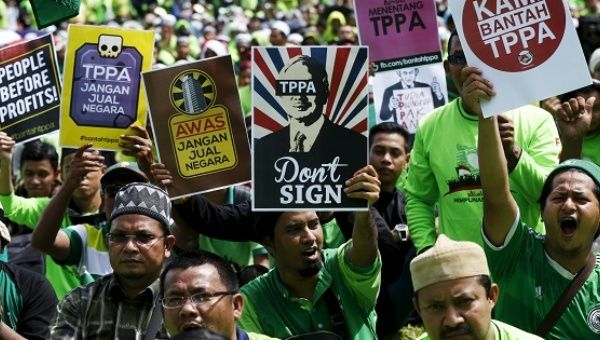 Activists protest the TPP days before parliament opened a debate on the free trade pact in Kuala Lumpur, Malaysia, Jan. 23, 2016.