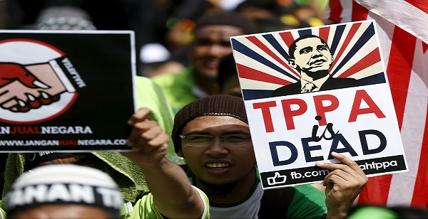 Protestors wave placards at a rally against the Trans Pacific Partnership (TPP) in Kuala Lumpur, Malaysia, Jan. 23, 2016.