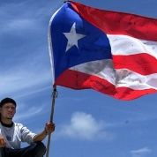 A Puerto Rican man holds up his nation