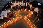 Staff members of a pharmaceutical college light candles to promote cancer awareness of World Cancer Day, Bengaluru, India Feb. 4, 2015.