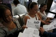 Colombian women listen as a health worker distributes information how to prevent the spread of the Zika virus, at the transport terminal in Bogota, Colombia January 31, 2016.