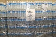 Stacks of bottled water wait to be distributed to the public in Flint after elevated lead levels were found in the city's water.