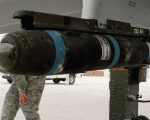 A U.S. Hellfire Missile strapped to a military jet.