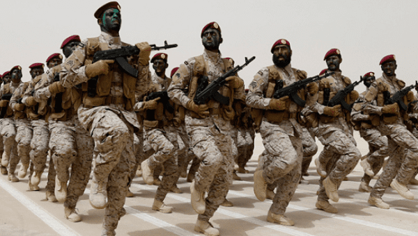 Saudi soldiers march during Abdullah