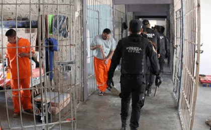 A handout picture provided by the Government of Monterrey shows police officers conducting a search in the Topo Chico Prison in Monterrey, Mexico, 14 Feb. 2016.