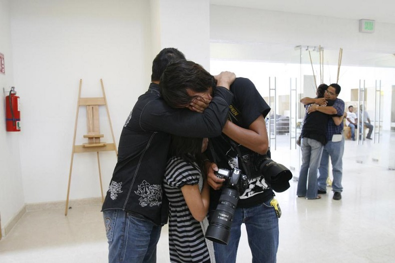 Friends, colleagues and family members embrace while mourning the death of Luis Carlos Santiago during his funeral in Ciudad Juarez September 18, 2010. Santiago, a 21-year-old news photographer working with Juarez-based newspaper El Diario, was killed after an attack by gunmen.