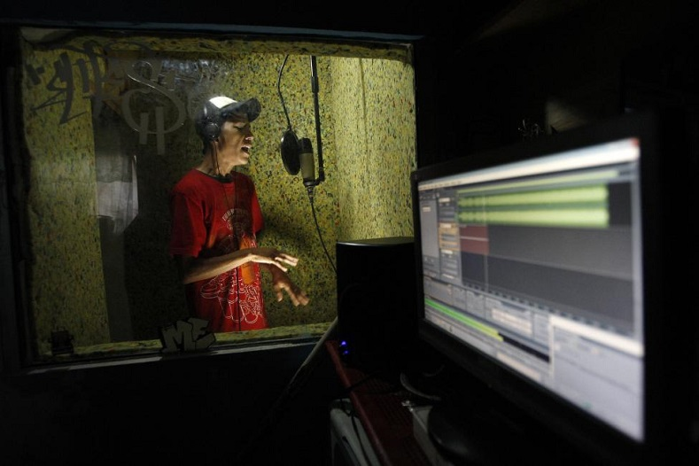 Rapper Pok 27 performs live in a home studio in Ciudad Juarez April 18, 2011. Young Mexican rappers are using Internet radio to vent their anger at the shocking killings sparked by the drug war, winning fans in cities from Los Angeles to Buenos Aires but also facing death threats from gunmen.