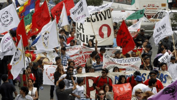Peruvian workers and activist protest against the 2015 IMF/World Bank Annual Meetings in Lima, Peru, Oct. 9, 2015
