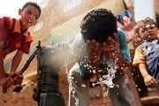 Egyptian children drink and wash in water from a hand pump in Qalyoubia village north of Cairo.