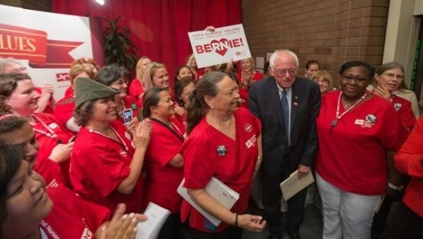 Democratic presidential candidate Bernie Sanders greets nurses as he arrives at a campaign rally at a National Nurses United office on August 10, 2015 in Oakland, California.