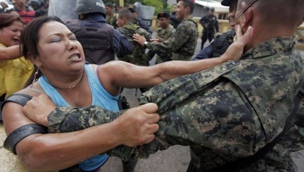 Police in Honduras repress women protesting violence against women.