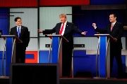 U.S. Presidential candidate Donald Trump gestures towards rivals Senator Marco Rubio and Senator Ted Cruz during the sixth Republican debate Jan. 14, 2016.