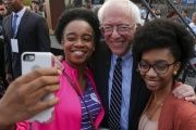 Senator Bernie Sanders poses for a photo with two supporters outside the Columbia Democratic Party headquarters.