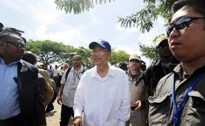 United Nations Secretary-General Ban Ki-moon, center, during a July 2014 visit to Haiti.