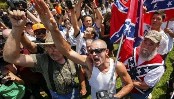 A supporter for the Ku Klux Klan and the Confederate flag yells at opposing demonstrators during a rally at the statehouse in Columbia, South Carolina July 18, 2015.